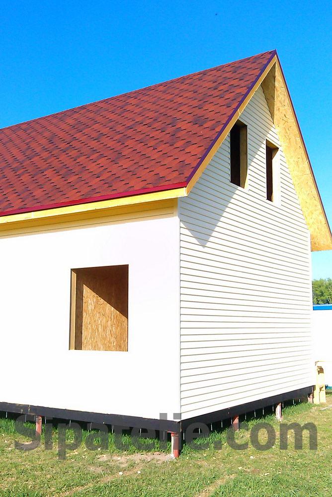 Наружная отделка дома сайдингом из сип панелей - фото 1